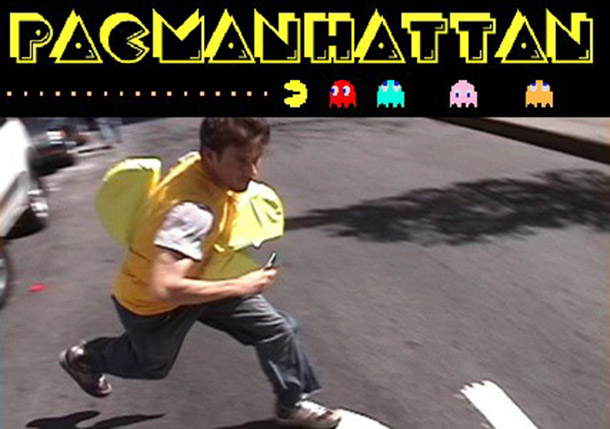 Figure 3 A Pac-Manhattan player dressed up as Pac-Man runs across a street to avoid ghost players. Image retrieved from http://pacmanhattan.com